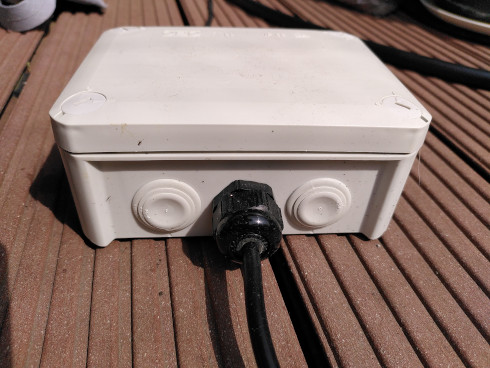 Cable gland on the side of a IP66 enclosure